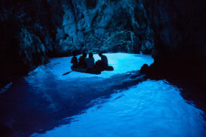 Exploring Blue cave with dinghy
