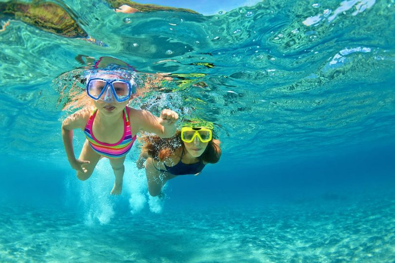 Snorkeling in the shallow sea of the Blue lagoon