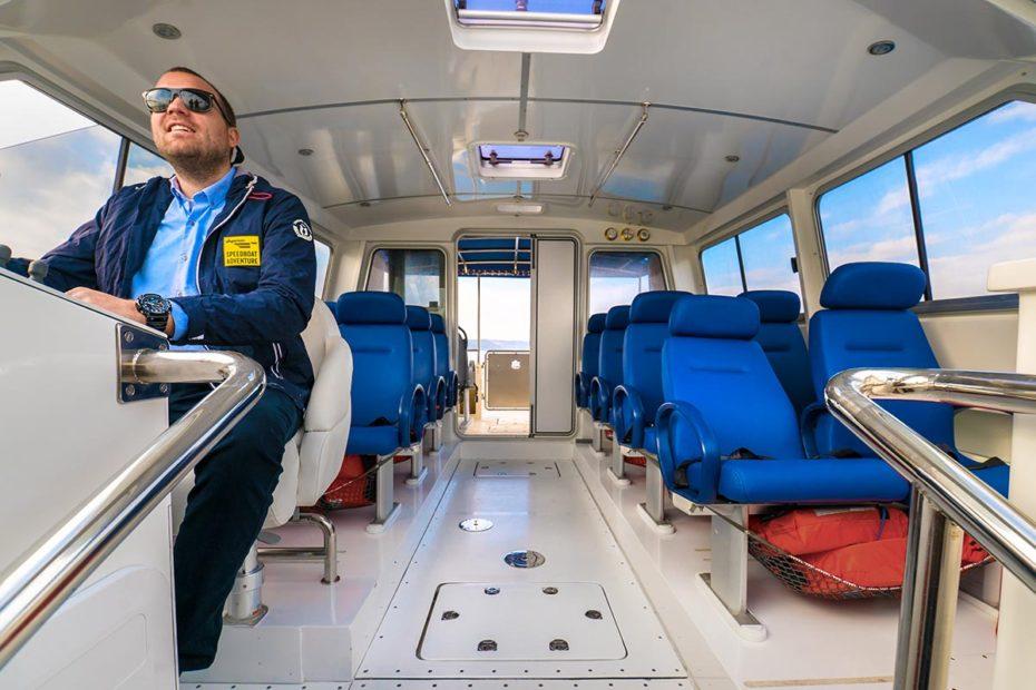 sugamantoursskipperinavigatingspeedboatfaros40
