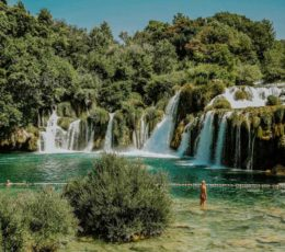 enjoying in the site of the falls inside Krka lake