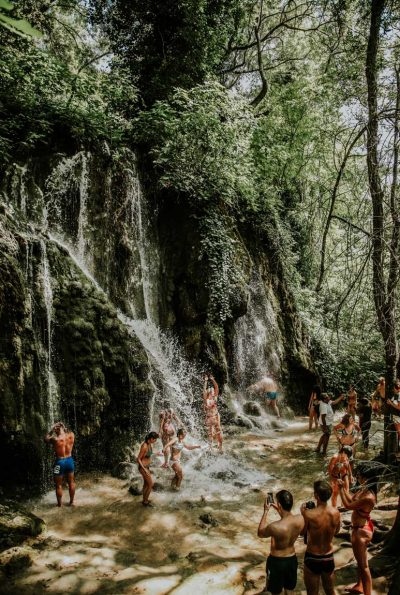 group shower under Krka falls