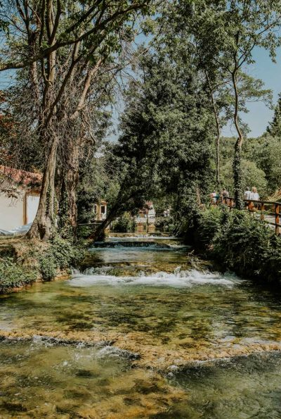 krka river running through picturesque village in Skradinski Buk