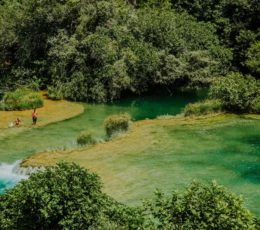 people swimming on Krka travertine system
