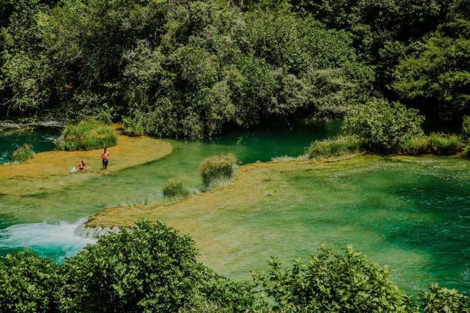 people swimming on Krka travertine system