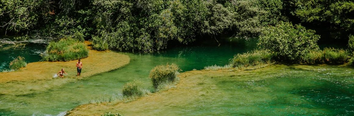 swimming-on-the-travertine-system-of-Krka-river