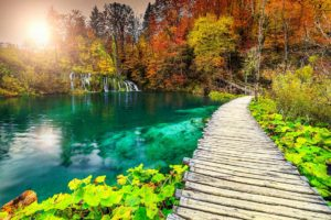 trail by the calm Plitvice lake in spring