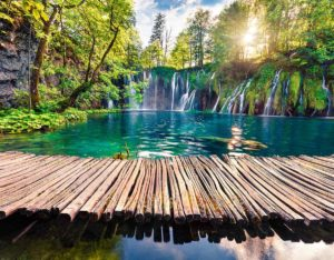Trail over the calm lake of Plitvice