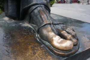 Golden toe of Gregury Nin statue
