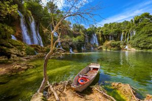 boat on the lake by Kravice falls