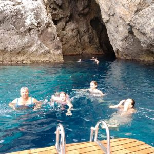 swimming-in-front-of-monk-seal-cave-bisevo-island